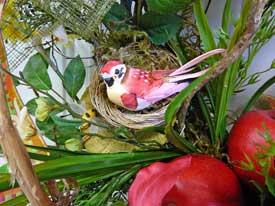 sweet bird on nest in wreath